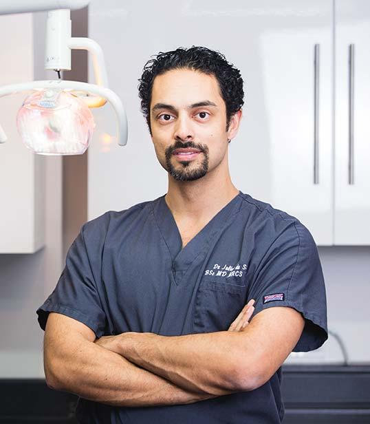 Dr. Julian de Silva, MBBS MD FRCO FACS BSc PGc DIC
