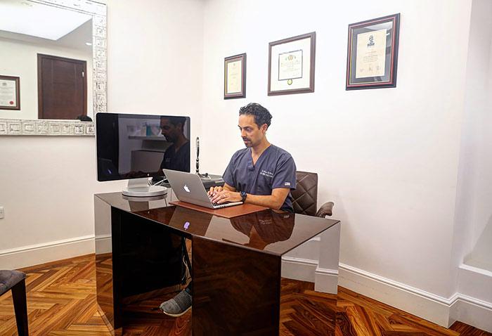 Julian De Silva and his work in office - photo